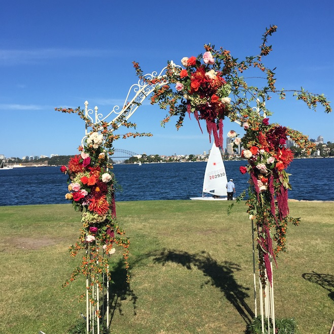 wedding arch with medium floral coverage