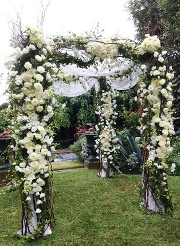 Seasonal-white-floral-and-foliage-arch-way-divine-events