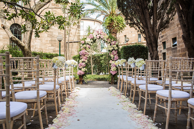 divine-events-ceremony-set-up-floral-archway-tiffany-chairs