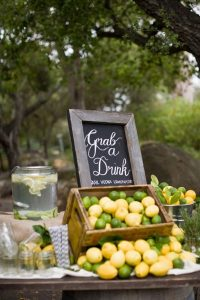 grab a drink refreshments signage with lemons and lime boxes