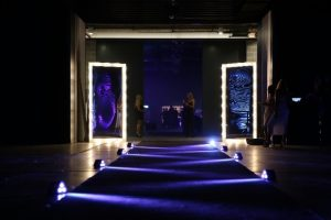 Blue lit entrance to corporate event