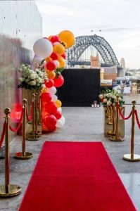 Red carpet bridge entrace with sydney harbour bridge in the background
