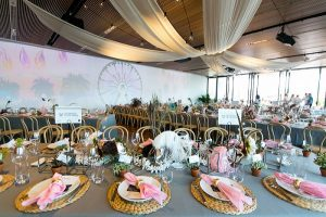 function with set tables and pink bouquets