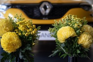 Yellow florals with yellow car in background