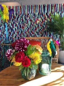 Bright ribbon backdrop with vases in the foreground