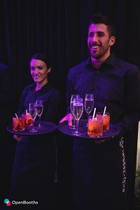 female and male waiter serving drinks