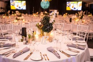 large function with set tables and golden cutlery