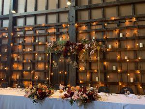 Rustic wedding backdrop with hanging globev lights