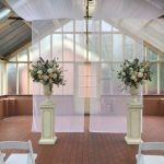 white floral plinths