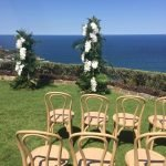 blonde bentwood chairs floral arch
